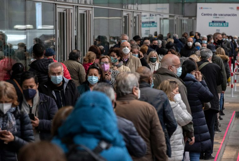 In this April 9, 2021, file photo, people queue to be vaccinated with the AstraZeneca vaccine against COVID-19 during a vaccination campaign at WiZink indoor arena in Madrid, Spain. (AP Photo/Manu Fernandez)
