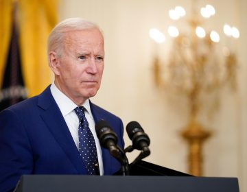Joe Biden speaks from a podium at the White House