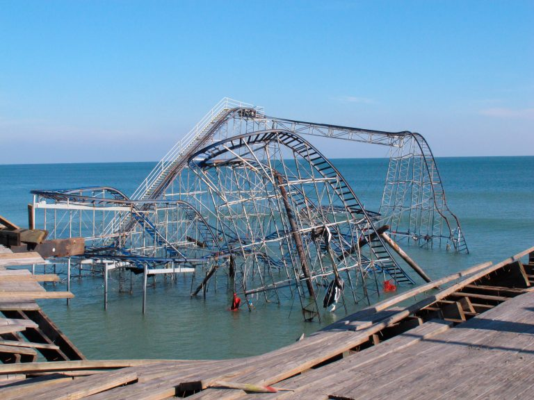 This Nov. 29, 2012 file photo shows the Jet Star roller coaster sitting in the ocean in Seaside Heights N.J. one month after Superstorm Sandy knocked it off Casino Pier into the water. (AP Photo/Wayne Parry)
