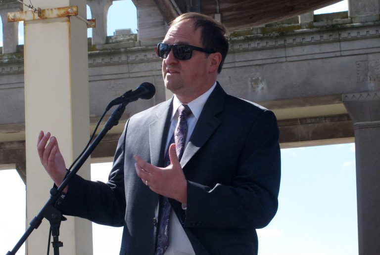 Michael Chait, president of the Greater Atlantic City Chamber of Commerce, speaks at a press conference on the Atlantic City, N.J. Boardwalk on April 30, 2021 at which he and other business and political officials called on New Jersey Gov. Phil Murphy to ease coronavirus restrictions enough to allow conventions and trade shows to resume in Atlantic City. (AP Photo/Wayne Parry)