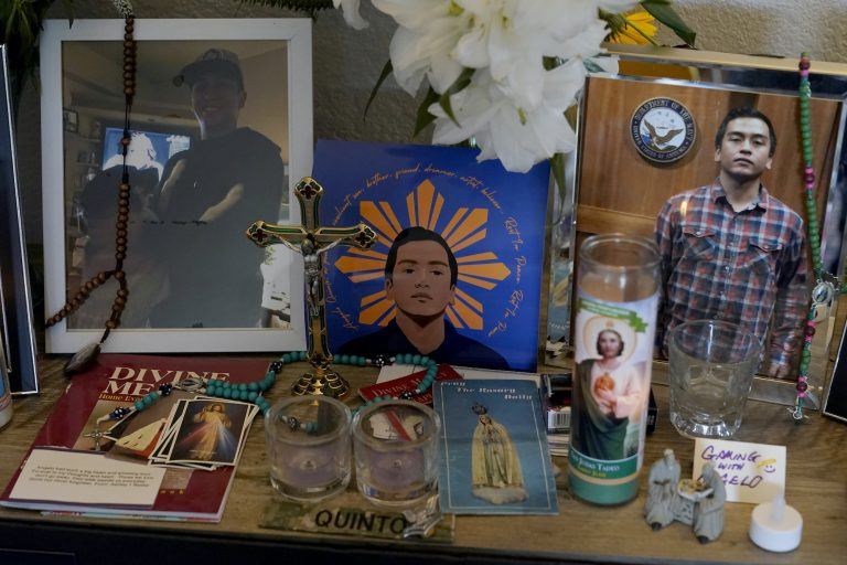 Images of Angelo Quinto are displayed at his family's home
