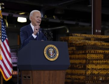 President Joe Biden delivers a speech from a podium