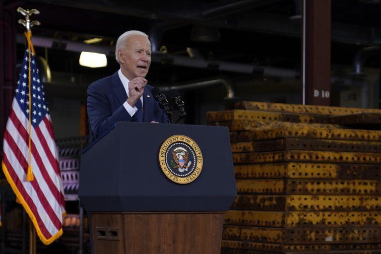President Joe Biden delivers a speech from a podium