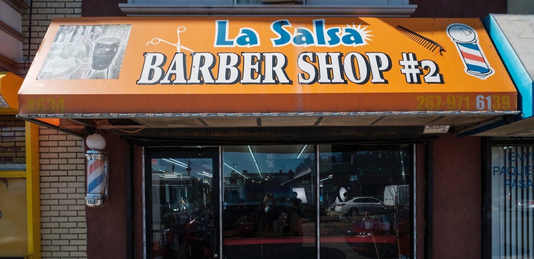 "La Salsa Barber Shop #2 is the second shop that Raymon ""La Salsa"" Rincón owns on North Fifth Street. | La Salsa Barber Shop # 2 es la segunda tienda que Raymon ""La Salsa"" Rincón tiene en North Fifth Street.(Photo by Bernardo Morillo/WHYY)"