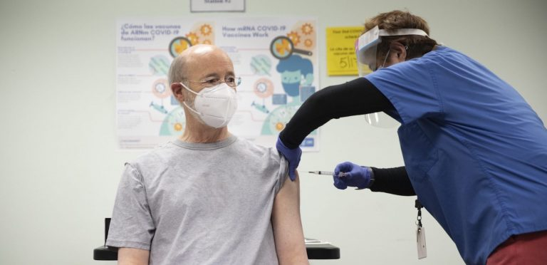 Pennsylvania Governor Tom Wolf receives a COVID-19 vaccine from Family First Health Care Medical Director Dr. Asceline S. Go in York on April 19, 2021. (Commonwealth Media Services)