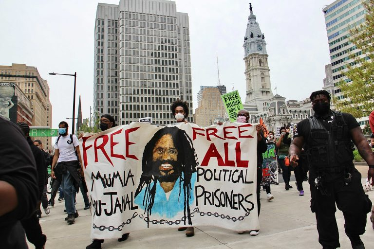 Protesters take to the streets to demand freedom for Mumia Abu Jamal. (Emma Lee/WHYY)