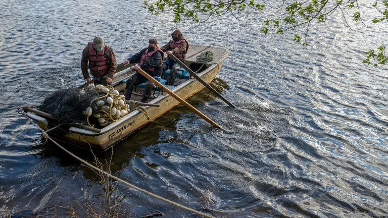 Steve Meserve and others row the Delaware River