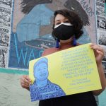 Artist Symone Salib helped create a poster campaign featuring portraits and quotes of previously incarcerated young people. (Kenny Cooper/WHYY)