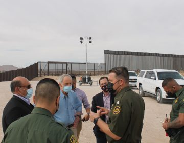 U.S. Sen. Tom Carper (in blue) of Delaware talks with members U.S. Border Patrol near El Paso, Texas. (courtesy Carper's office)