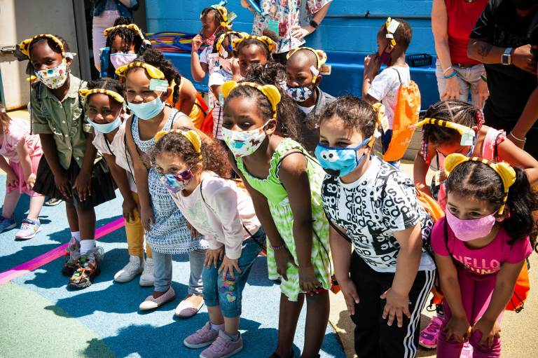 A group of kids with masks on
