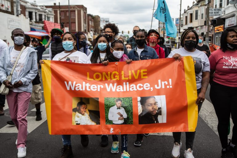 Protesters carry a banner in honor of Walter Wallace Jr.