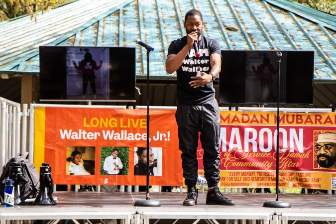 Jon McKay, founder of Life Outside the Streets, talks to the crowd about mental health in communities at Malcolm X Park