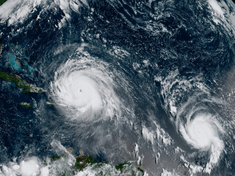 A satellite image from September 2017 shows Hurricane Irma, left, and Hurricane Jose, right, in the Atlantic Ocean. NOAA says the average annual number of tropical storms in the Atlantic has slightly increased. (NOAA/GOES-16/AP)