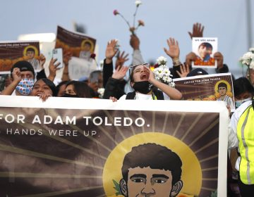 Demonstrators attend a peace walk honoring the life of 13-year-old Adam Toledo