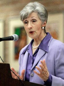 Doris Meissner speaks from a podium