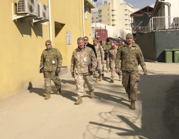 Marine Gen. Frank McKenzie, (center) is shown visiting Kabul, Afghanistan in January 2020. The Biden administration said it plans to complete a draw down of U.S. troops in the country by Sept. 11. Lolita Baldor/AP