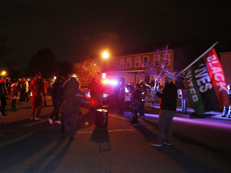 A crowd gathers to protest in the neighborhood where a Columbus police officer fatally shot a Black teenage girl