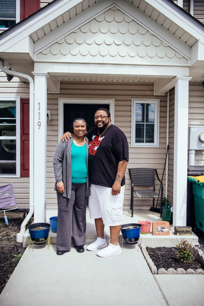 Marcia and Jonathan Pretlow outside of their home