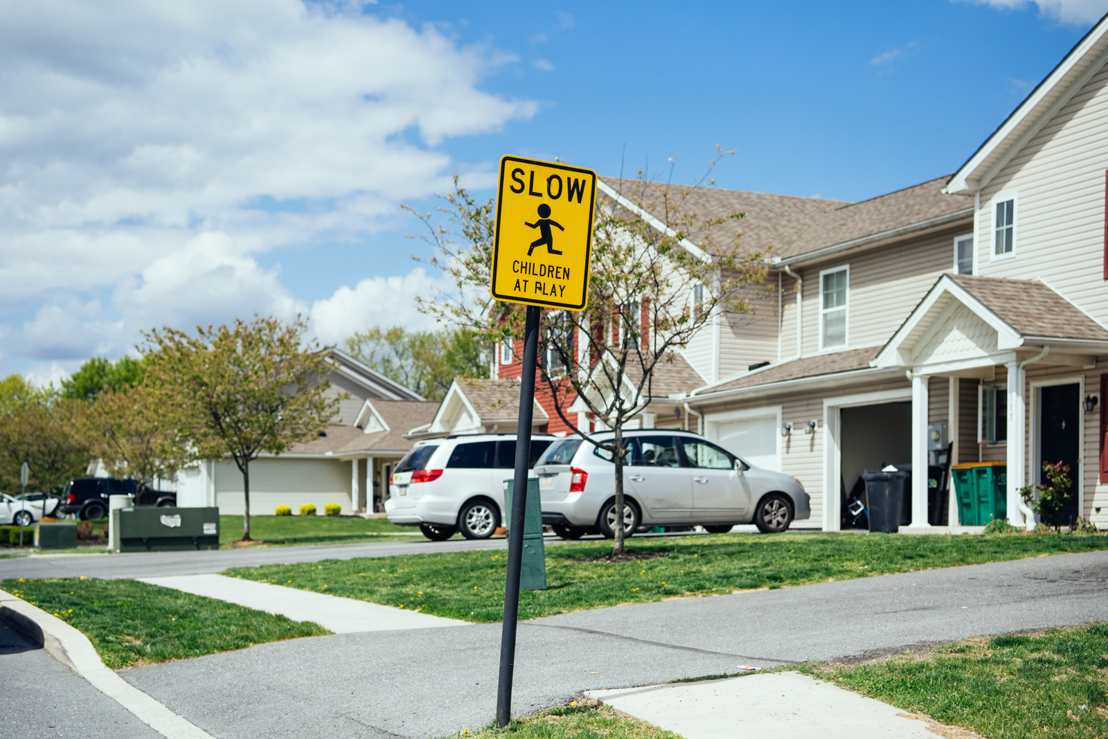 "A ""Slow: Children at Play"" sign is pictured outside Redwood Park Townhomes"