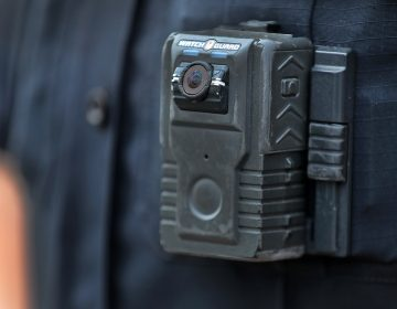 Police officer David Moore is pictured wearing a body camera in Ipswich, Mass., on Dec. 1, 2020. The city was among 25 statewide awarded grants to purchase body-worn cameras for videotaping interactions with the public. A new study says the benefits to society and police departments outweigh the costs of the cameras. (Boston Globe/Boston Globe via Getty Images)