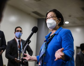 Sen. Mazie Hirono speaks into a mic at the Capitol