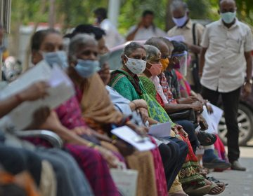 People wait for their turn to receive the COVID-19 vaccine