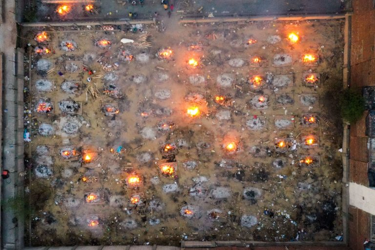 Burning pyres of victims who lost their lives due to the coronavirus are seen at a cremation ground in New Delhi