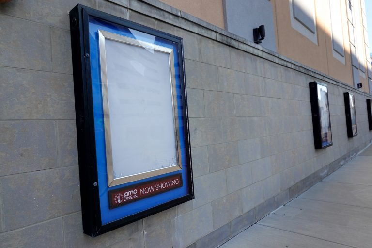 Empty frames that would normally hold movie posters hang on the front of an AMC theater shuttered by the coronavirus pandemic on Dec. 4, 2020, in Rosemont, Ill. (Scott Olson/Getty Images)