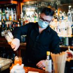 A bartender makes a drink at The Belvedere Inn in Lancaster. (Kate Landis/WITF)