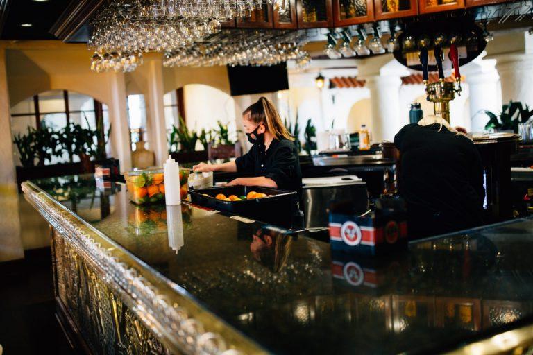 A bartender works in Lancaster. (Kate Landis/WITF)