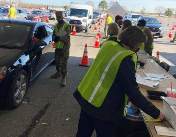 Medical Reserve Corps members work with the National Guard and state public health employees in giving vaccinations at Delaware's mass events, like this one at Dover International Speedway. (Courtesy of Mary Kampman)