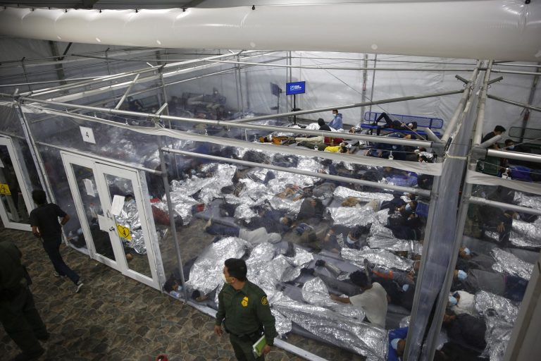 In this March 30, 2021, file photo, young minors lie inside a pod at the Donna Department of Homeland Security holding facility, the main detention center for unaccompanied children in the Rio Grande Valley run by U.S. Customs and Border Protection (CBP), in Donna, Texas. (Dario Lopez-Mills/AP Photo)