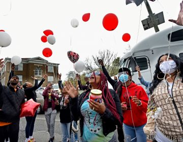 Tomeka Holmes (center) leads family and friends in a balloon release in her son's memory