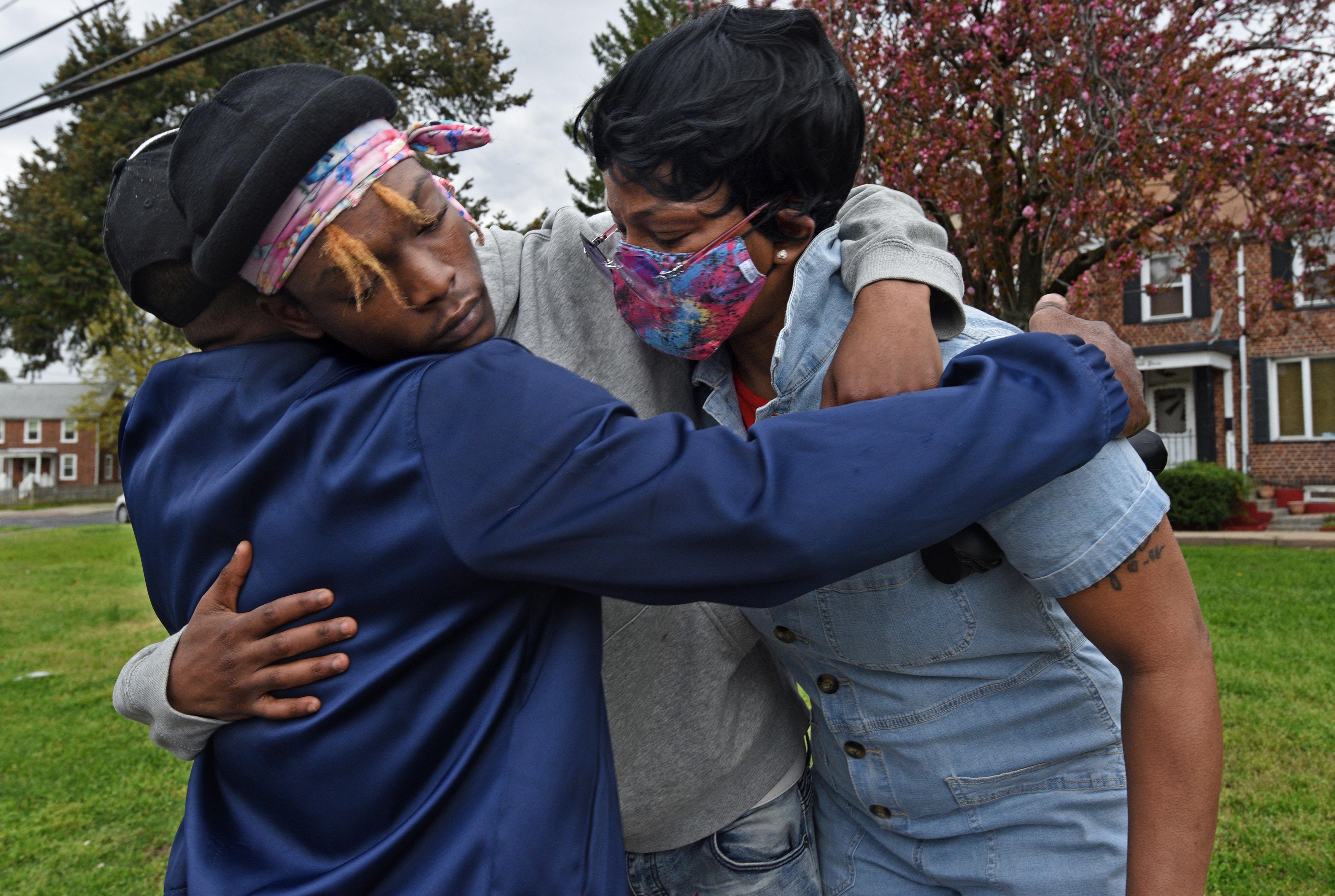 Deshine Barnes and Sharrell Barnes receive a hug