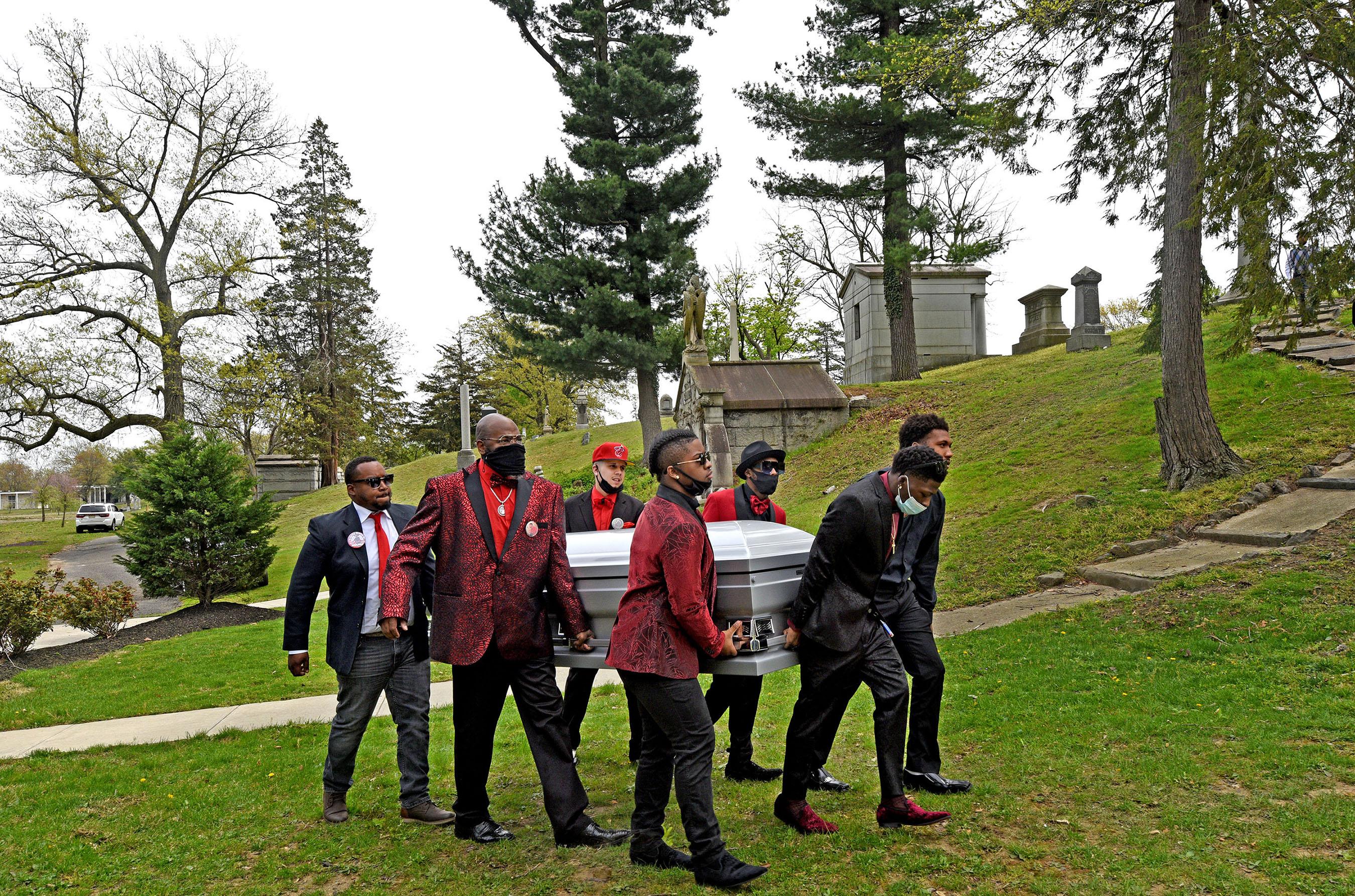 Pallbearers carry the casket of Nah'Jole Frazier