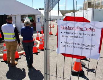 A sign indicates that Philly's FEMA vaccination site is rescheduling appointments Tuesday