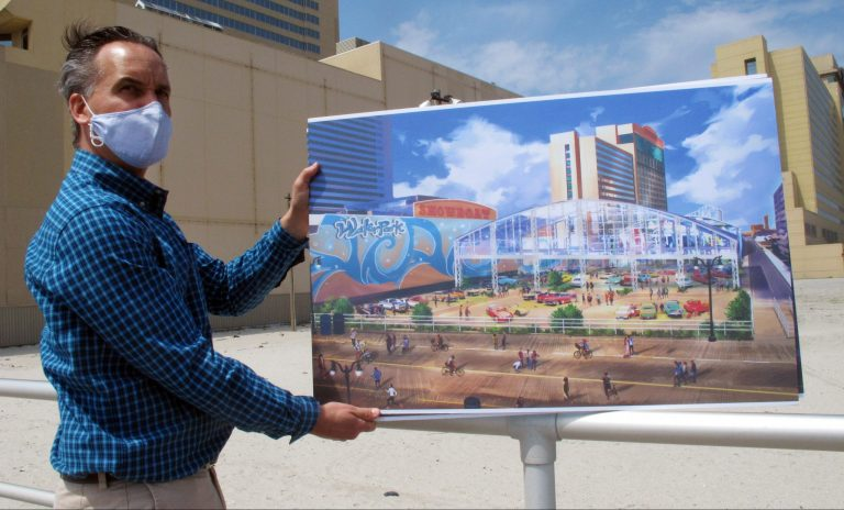 Martin Sizmur, who is in charge of construction for Philadelphia developer Bart Blatstein, shows an illustration of an 8,000-seat domed concert hall to be built next to the Showboat casino, Wednesday, April 21, 2021, in Atlantic City, N.J.