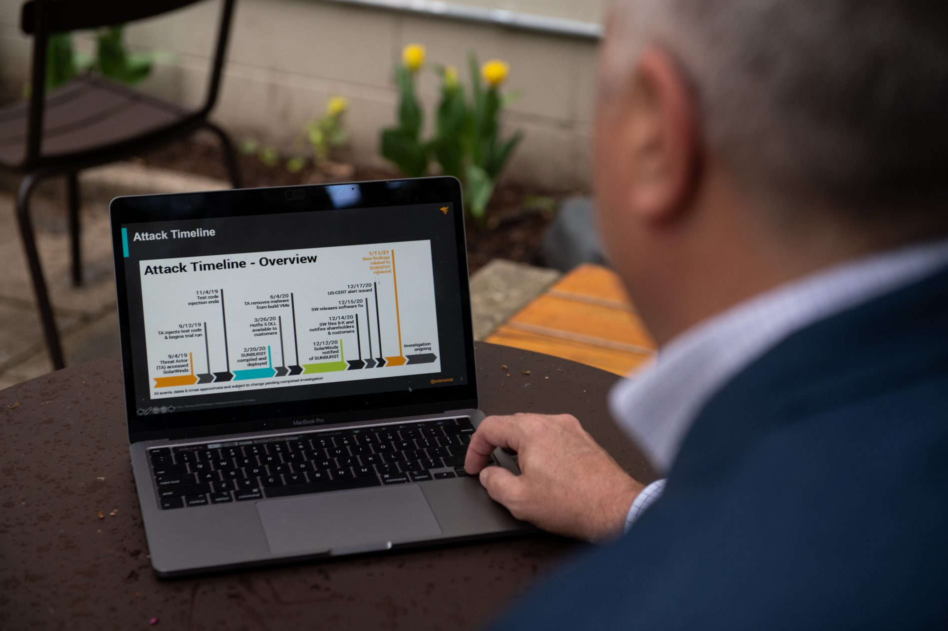 Plesco shows a timeline of the SolarWinds hack on his computer. (Kriston Jae Bethel for NPR)