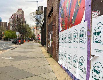 Oat milk ads cover street art on South Broad Street.