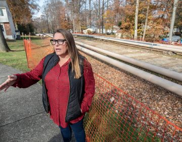 Rebecca Britton stands outside near pipeline construction