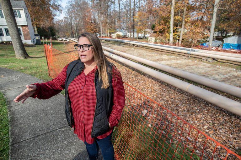 Rebecca Britton stands outside near pipeline construction