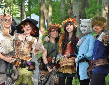 A group of people dressed up in costumes at the New Jersey Renaissance Faire