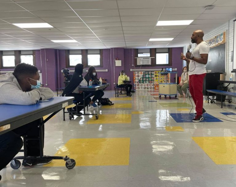 Kamau Stanford, chief operating officer for the Philadelphia Black Doctors COVID-19 Consortium, speaks to students at Mastery Charter School's Shoemaker campus Friday. (Johann Calhoun/Chalkbeat)