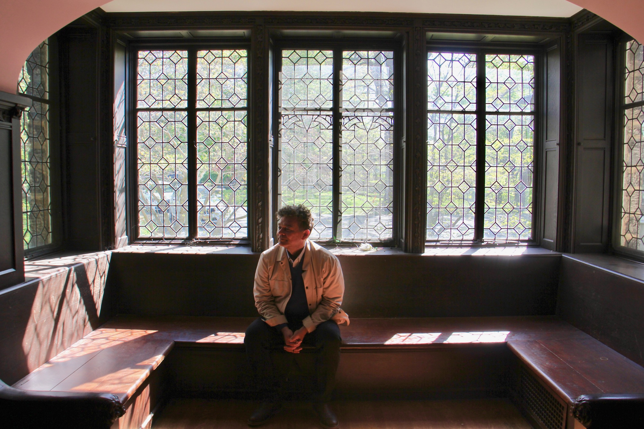 William Valerio, director of the Woodmere Art Museum sits in the Rose Room at St. Michael Hall, envisioning the room as a performance venue. (Emma Lee/WHYY)