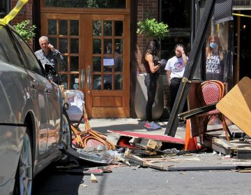 A car crashed into an outdoor dining structure on 4th Street in Northern Liberties, injuring several patrons at Cafe La Maude. (Emma Lee/WHYY)