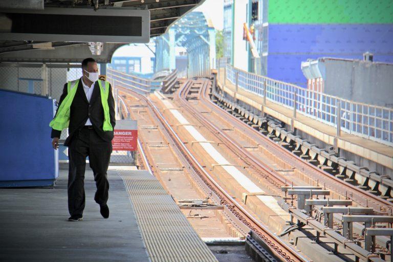 Assistant Director of Transportation Ken Divers, who leads the vulnerable population task force at SEPTA, walks on the platform at Somerset Station. (Emma Lee/WHYY)