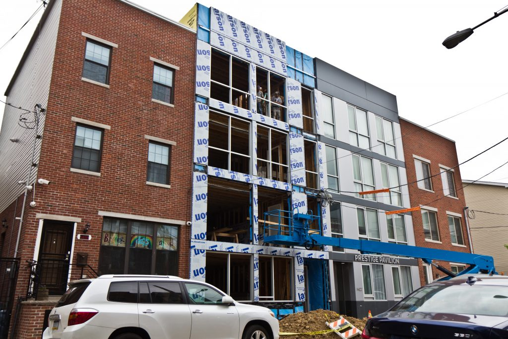 Prestige Design and Construction development in process on the 1400 block of North 7th Street in May 2021. (Kimberly Paynter/WHYY)