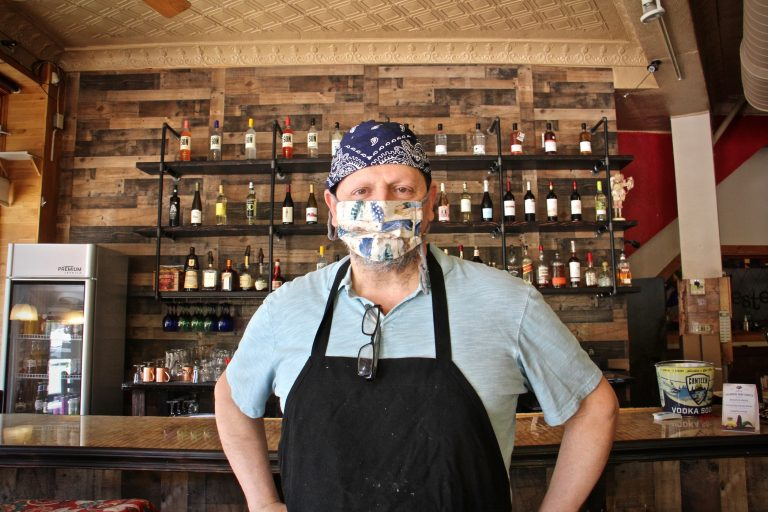 Mike Scotto wears a mask inside Jester's Cafe