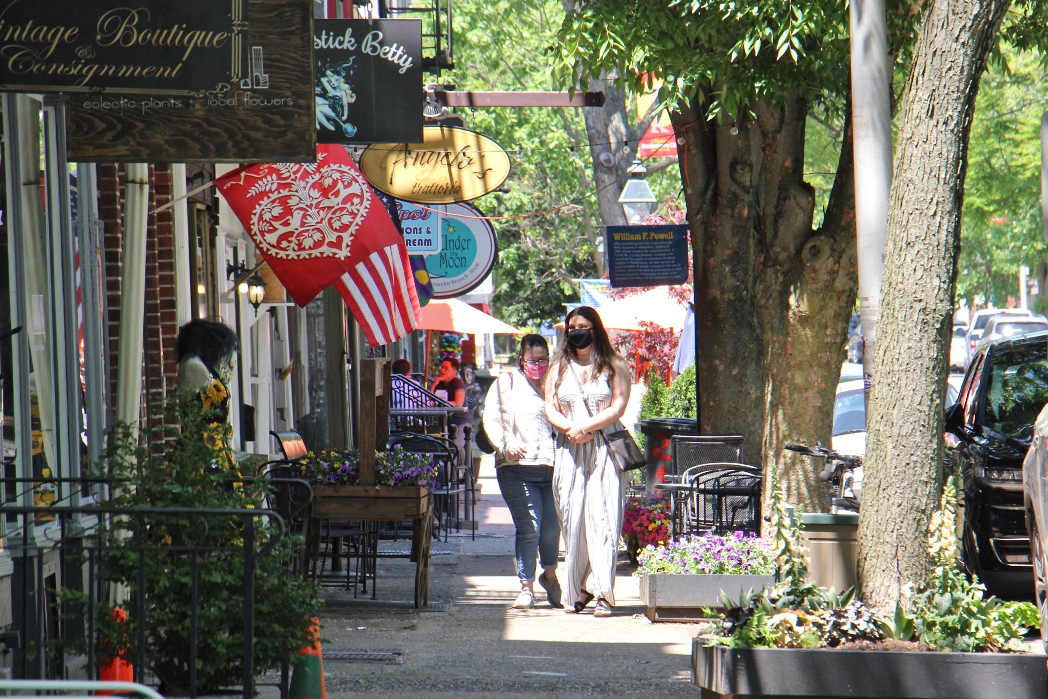 Shoppers walk on Farnsworth Avenue