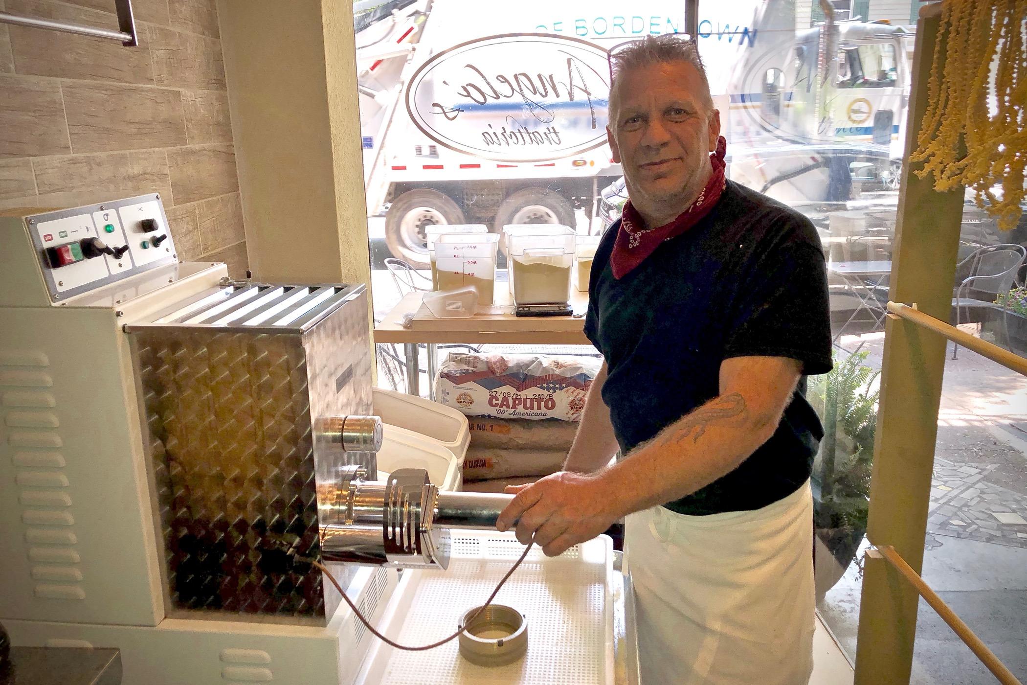 Robert Melker prepares food at Angelo's Trattoria